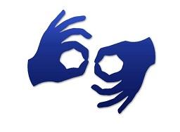 Dwie dłonie, granatowe na białym tle, pokazujące znak w języku migowym